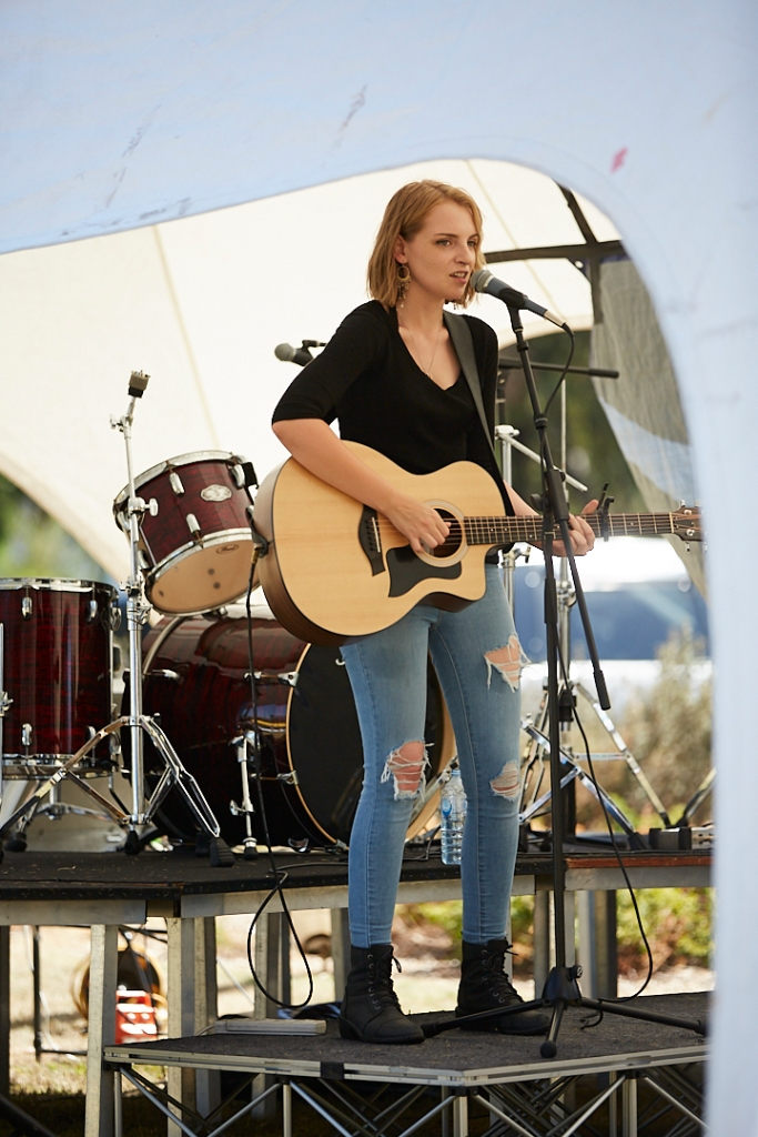 Brigid Parker plays guitar on the Youth Stage at Celebrate Mooroolbark 2019. Photo by Nicole Squelch.